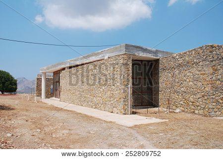 TILOS, GREECE - JUNE 20, 2018: The visitor centre at the Cave of Charkadio on the Greek island of Tilos. The bones of prehistoric Pigmy Elephants were discovered in the cave in 1971.