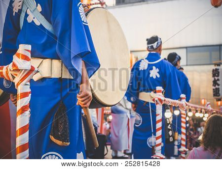 Drummer Performance, Taiko Drums Japanese Folklore. Japanese Artists Perform At Bon Festival In Blue