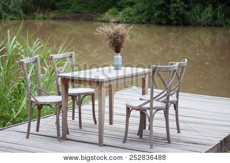 Wooden Tables Outside Coffee Shop, Stock Photo