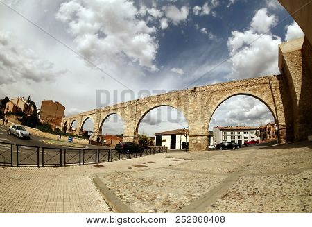 Beautiful View Of Teruel With Famous Los Arcos Aqueduct, Aragon, Spain. Popular Tourist Attraction I