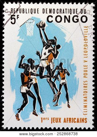 Luga, Russia - January 23, 2018:  A Stamp Printed By Congo Shows Basketball Players, Circa 1965