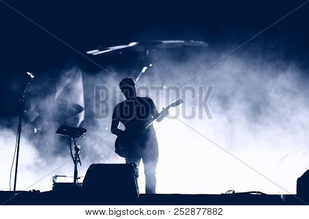 Guitarist Silhouette On The Stage