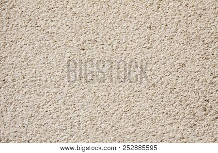 Beige Cement Plaster Wall As Background Or Texture