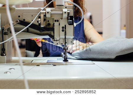 Cropped View Of A Woman Sewing A Leather Design To Upholstering The Interior Car Components With The