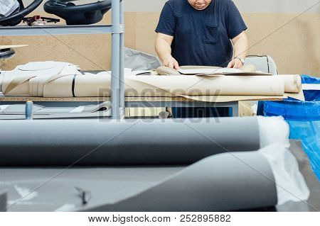 Cropped View Of A Male Worker Working On A Work Table On A Upholstery Leather Factory Upholstering A