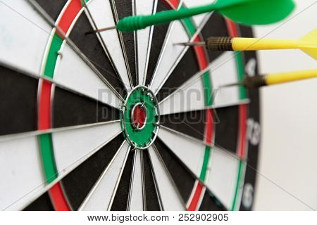 Yellow dart missed the target and hit on the white space bacground, Missed Target Concept