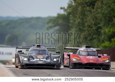 August 05, 2018 - Elkhart Lake, WI, USA:  The Mustang Sampling Racing Cadillac DPI car races through the turns at the Continental Tire Road Race Showcase at Road America in Elkhart Lake, WI.