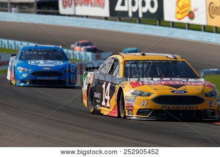 August 05, 2018 - Watkins Glen , New York, USA: Clint Bowyer (14) brings his car through the turns during the Go Bowling at The Glen at Watkins Glen International in Watkins Glen , New York.