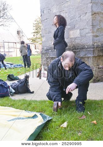 Justine Freeman Is The First One To Pitch His Tent At The Occupy Exeter Site Of Exeter Cathedral Gre