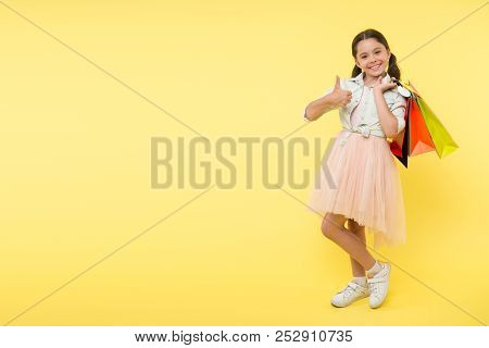 Go Shopping. Go Shopping With Happy Small Kid. Small Girl Go Shopping And Show Thumb Up. Go Shopping