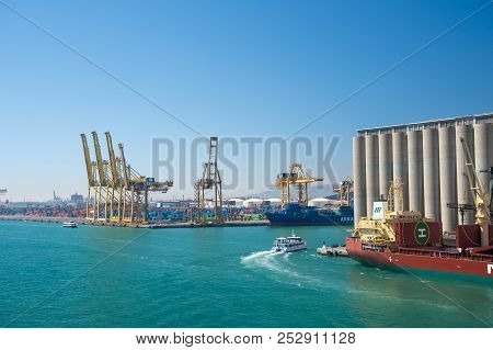Barcelona, Spain - March 30, 2016: Sea Port On Blue Sky. Container Port. Trade And Commerce Activity