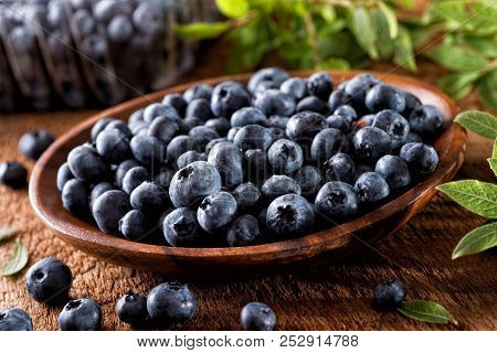 Fresh Organic Blueberries In A Wooden Bowl.