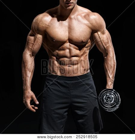 Close Up Of Man Showing Muscular Body And Six Pack Abs. Photo Of Man Shirtless With Dumbbell On Blac