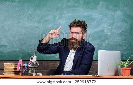 Teacher Bearded Man Tell Interesting Story. Teacher Charismatic Hipster Sit Table Classroom Chalkboa