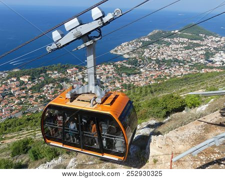 Dubrovnik, Croatia - August 4 2018: Cable Car Reaching Top Of Mountain Above Dubrovnik