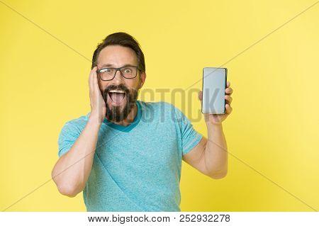 Fantastic Application. Guy Eyeglasses Overwhelmed By New Smartphone Application. Man Bearded Happy U