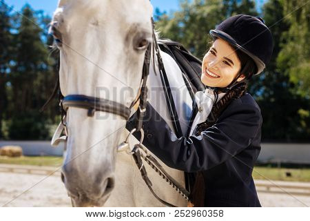 Dark-eyed Horsewoman With Long Braid Feeling Contended