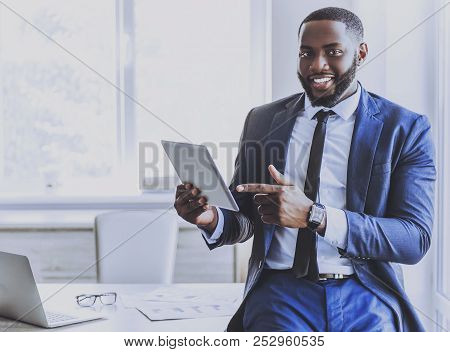Handsome Afro-american Businessman Using Tablet While Working In Office. Manager In Suit. Handsome E