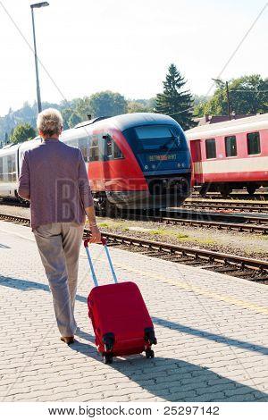 mature senior  at the train station