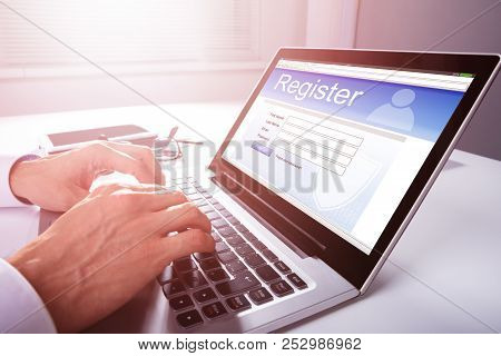Businessman Filling Online Registration Form