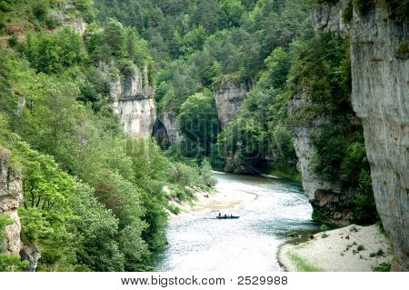 The Tarn river dominated by the spectacular cliffs of the Sauveterre and Mejean causses near La Malene in the Tarn Gorges. The gorges are very popular for canoe and kayak activities as well as for hiking and trekking - Department of Lozere France poster