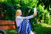 Lady pretty bookworm busy read book outdoors sunny day. Literary critic. Woman concentrated reading book in garden. Woman prepare review about bestseller. Girl sit bench read book nature background poster