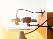 Camera on the friction arm. Studio setup. Articulating magic friction arm large super clamp crab plier poster