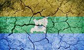 North Caribbean Coast Autonomous Region,  autonomous regions in Nicaragua, flag on dry earth ground texture background poster