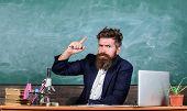 Teacher bearded man tell interesting story. Teacher charismatic hipster sit table classroom chalkboard background.Teacher interesting interlocutor as best friend. Telling educational stories poster