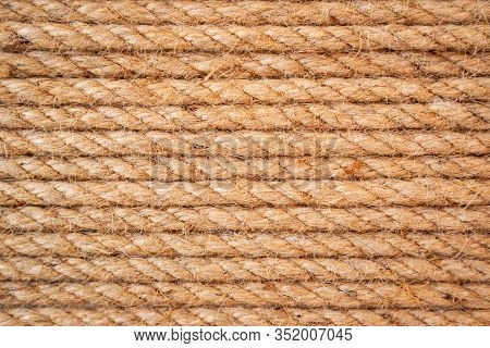 Brown Twisted Rope In Aline. Brown And Yellow Rope Textured Background. Rope Pattern For Background
