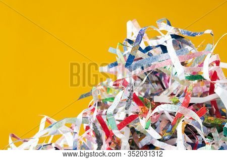 Closeup Shredded Paper Texture And Reuse Colorful Paper Scrap Of Document On Yellow Paper Background