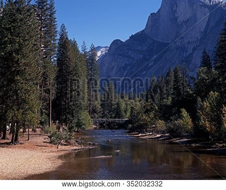 Bridge Across Merced River With Mountains To The Rear, Yosemite National Park, California, Usa