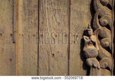 Detail of woodcarvings at the Shwe In Bin teak monastery in Mandalay, Myanmar (Burma)