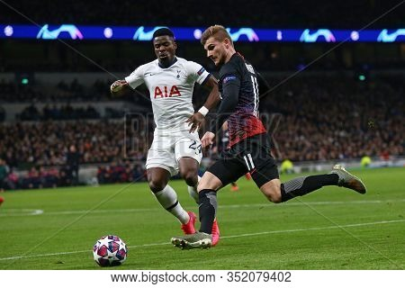 LONDON, ENGLAND. 19 FEBRUARY 2020. Forward Timo Werner Of Leipzig and Defender Serge Aurier of Tottenham during the UEFA Champions League match between Tottenham Hotspur and RB Leipzig,