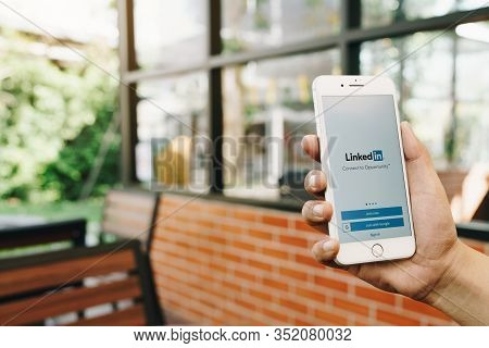 Chiang Mai, Thailand - Feb.17,2020: Man Holding Apple Iphone 8 Pius With Linkedin Application On The