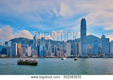HONG KONG, CHINA - MAY 1, 2018: Hong Kong skyline cityscape downtown skyscrapers over Victoria Harbour on sunset. Hong Kong, China