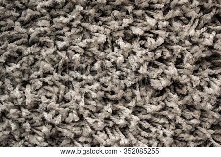 Texture Of Grey Long Pile Carpet. Abstract Background Of A Shaggy Texture With Long Fibers