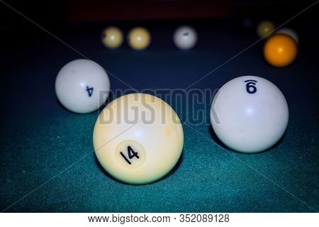 Billiard Balls On A Background Of Green Cloth Close-up.
