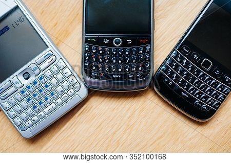 London, United Kingdom - Apr 21, 2013: Overhead View Of Three Modern Smartphones Telephones Manufact