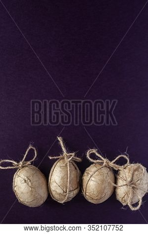 Easter Eggs Decorated With Crafty Paper And Ribbon On The Dark Background
