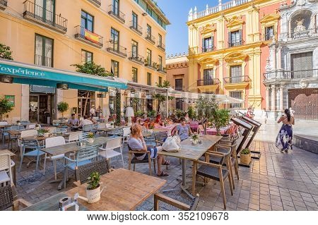 Malaga, Spain - October, 2019: Walking Malaga Old Town Streets. View Of Open Air Street Cafe