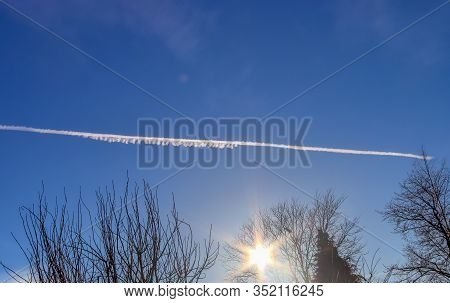 Big Aircraft Contrail In A Blue Sky In Summer