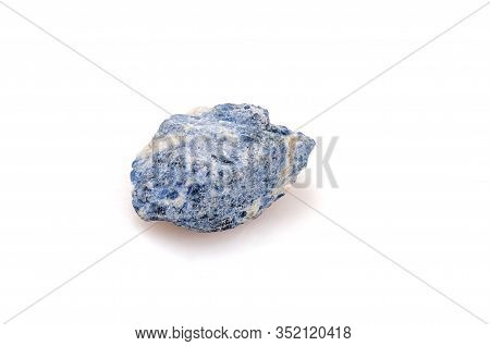 Natural Stone Sodalite On A White Background. Blue Nugget. Gemology.