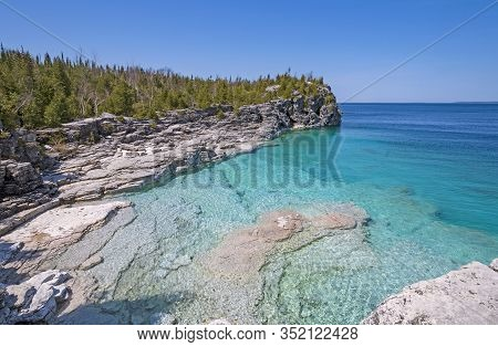 Clear Waters In A Gray Cliffed Cove At Indian Cove In Bruce Peninsula National Park In Ontario