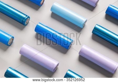Close Up Of Colorful  Used Rechargeable Nickel Metal Hydride (ni-mh) Battery On Grey Background, Fla