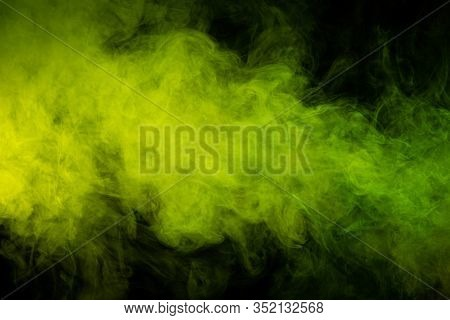 Toxic Movement Of Color Smoke Abstract On Black Background, Fire Design. Fantasy Green Smoke Abstrac