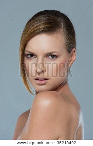 Beauty Portrait Of Serous Girl Isolated On Gray