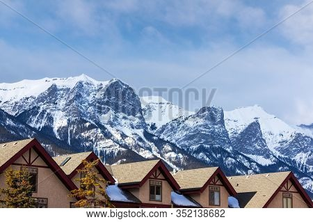 Rows Of Houses In The Canadian Rockies Of Canmore, Alberta, With Spectacular View Of Rundle Mountain