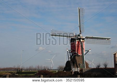 Red Colourd Old Four Corner Wooden Windmill At Zoeterwoude In The Netherlands