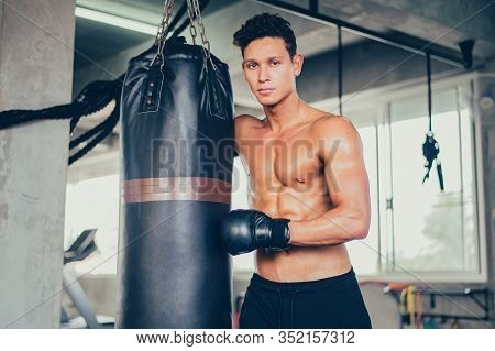 Sport Man Boxing At Fitness Gym. Mental Health And Wellness. Fit And Firm For Healthy. Mind-body Imp